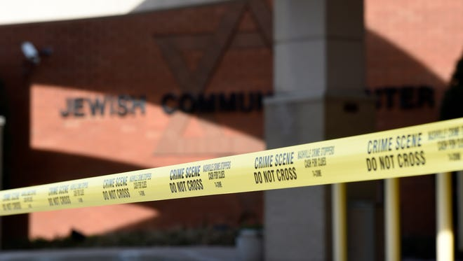 Police tape is posted outside the Gordon Jewish Community Center in Nashville on Jan. 9, 2017, after a bomb threat forced the evacuation of the building.