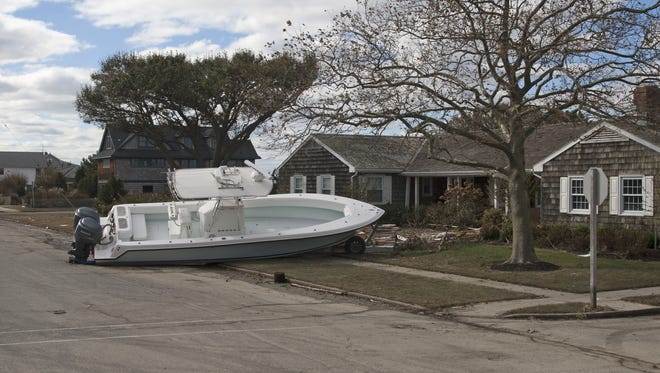 A boat sits on the lawn of a house along the bayside of Beach Haven after superstorm Sandy.