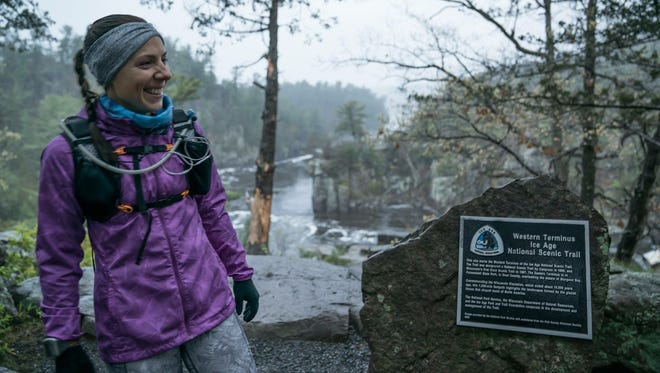 Annie Weiss stands at the western terminus of the Ice Age Trail in Interstate State Park in Polk County, the beginning of her journey to run the 1,200-mile trail in 19 days.