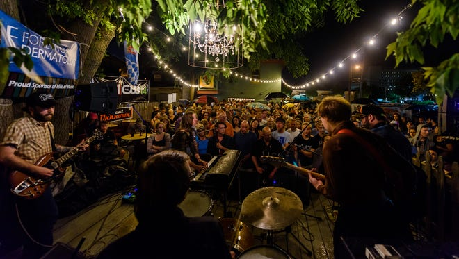 Dusk plays to a packed Fox River House patio during Mile of Music in 2016.