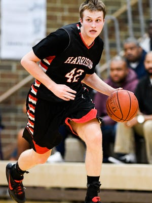 Harrison's Rilee Epley brings the ball down the court as the Henderson County Colonels play the Evansville Harrison Warriors for Henderson's season opener at Colonel Gym Tuesday, November 29, 2016.