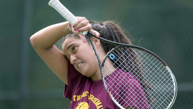 Dugleisy Linarez wipes the sweat off her face during a tennis game with a friend at Currie Park on July 26, 2019 in West Palm Beach.