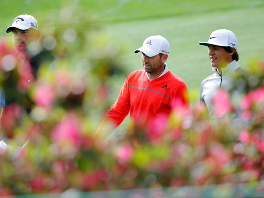 Thorbjorn Olesen (right), Sergio Garcia (center) and Thomas Bjørn walk along of azaleas on the 6th hole.