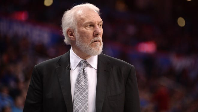 San Antonio Spurs head coach Gregg Popovich reacts to a play against the Oklahoma City Thunder during the fourth quarter at Chesapeake Energy Arena.