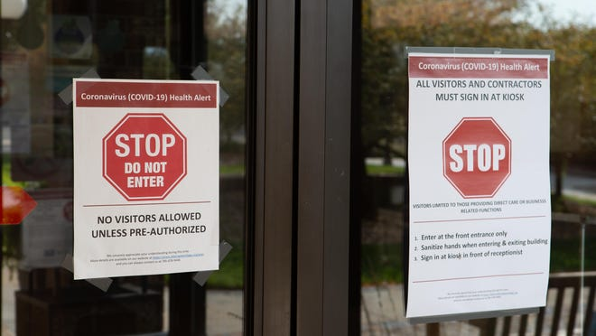 Signs at Aldersgate Village's Life Plan Community warn visitors of restrictions in place due to the coronavirus. Most nursing homes have had to cut off visitor access to control the spread of the virus, as it has proven to be more deadly among elderly populations and those with preexisting medical conditions.