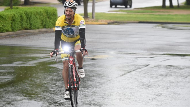 Pastor Bill Ondracka pedals into the parking lot at Redeemer Lutheran Church in Mountain Home on Wednesday. Ondracka is on a 1,200-mile bike trip to promote awareness of the Lutheran Church and the work the church does in local communities.