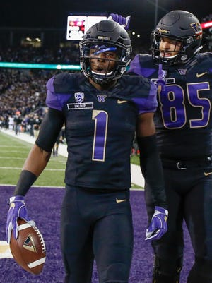 Wide receiver John Ross of the Washington Huskies is congratulated by tight end David Ajamu after scoring a touchdown against USC.