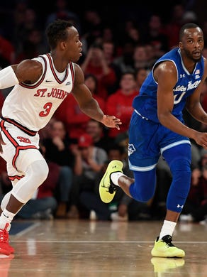 Seton Hall guard Quincy McKnight (0) dribbles the ball against St. John's guard Rasheem Dunn (3) during the first half of an NCAA college basketball game in New York, Saturday, Jan. 18, 2020. (AP Photo/Sarah Stier)