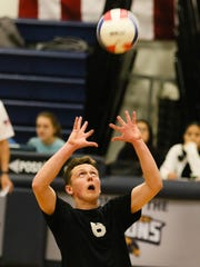 Dover sophomore setter David Hoyt passes the ball during a boys volleyball match at Jefferson Township High School  on April 06, 2018.