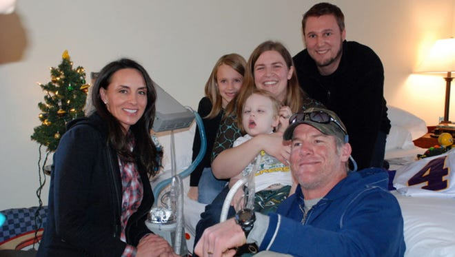 Brett and Deanna Favre pose with the Butzine family. The family (from left) is Ella, Jon, Michelle and Anderson.