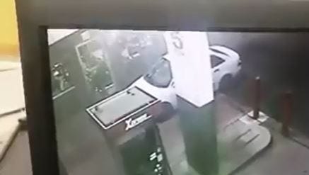 Surviellance footage catches a would-be burglar hammering on a gas station door before fleeing early Wednesday morning.