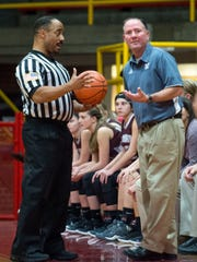 Mount Vernon Head Coach Doug Blair talks to the referee as the Mater Dei Wildcats take on the Mount Vernon Wildcats at Mater Dei High School in Evansville, Ind., on Tuesday, Dec. 5, 2017.