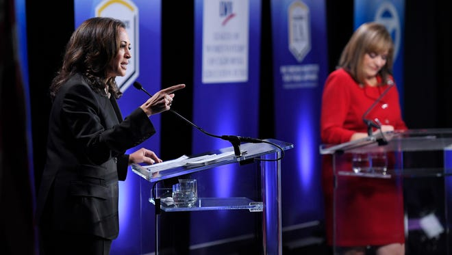 California Attorney General Kamala Harris, left, speaks as Rep. Loretta Sanchez, center, listens during a debate earlier this month in Los Angeles.