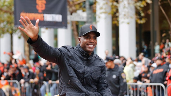 Barry Bonds rides a float in the Giants' 2014 World Series  victory parade. He served as a special instructor for the club that spring.