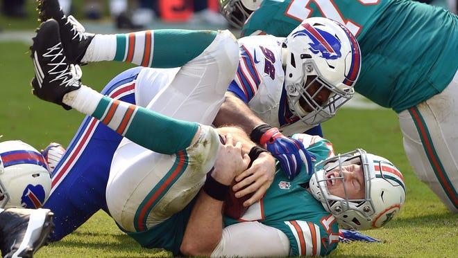 Buffalo Bills rookie Adolphus Washington sacks Miami Dolphins quarterback Ryan Tannehill during a game earlier this season. Washington returns to his hometown of Cincinnati to play the Bengals this week.