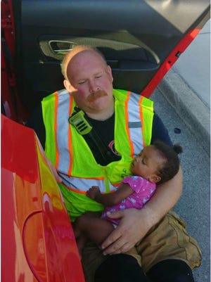 Chattanooga firefighter Chris Blazek calmed this baby after a car crash.