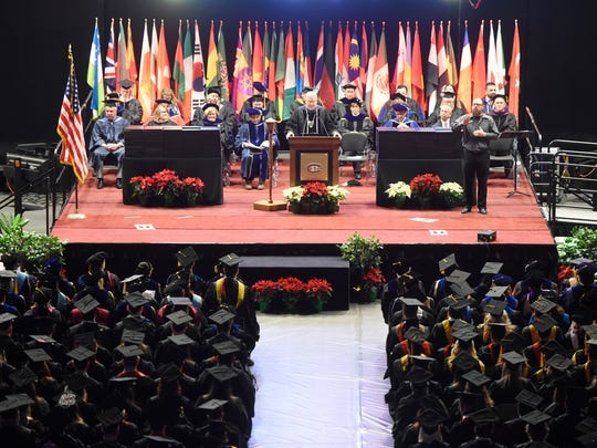 St. Cloud State University President Earl Potter speaks during Friday's fall semester commencement ceremony at Halenbeck Hall.