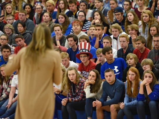 Cathedral High School students listen as U.S. Olympian