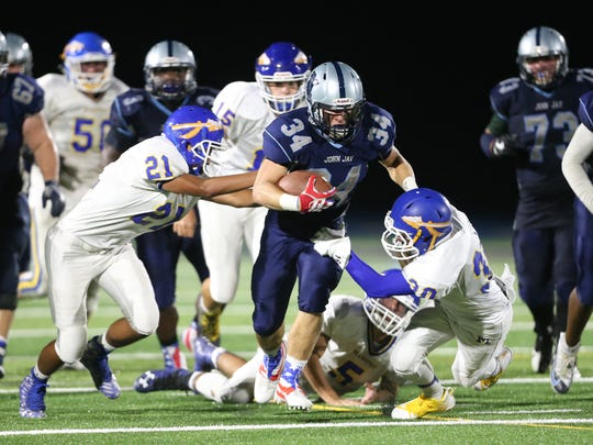 John Jay's James Luciano breaks several tackles during