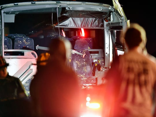 The interior of a charter bus can be seen as it sits in the eastbound lanes of U.S. 30 just west of the Wrightsville exit early Saturday. Hellam Fire Company Chief Eric Strittmatter said a 1:02 a.m. call reported a westbound Ford Explorer crossed the median and collided with a charter bus transporting the Eastern York varsity football team back to the school after a Friday night game.