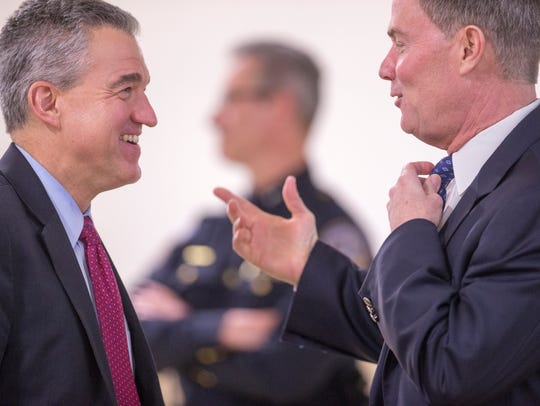 U.S. Attorney Josh Minkler (left) chats with Indianapolis Mayor Joe Hogsett, who formerly held Minkler's office.