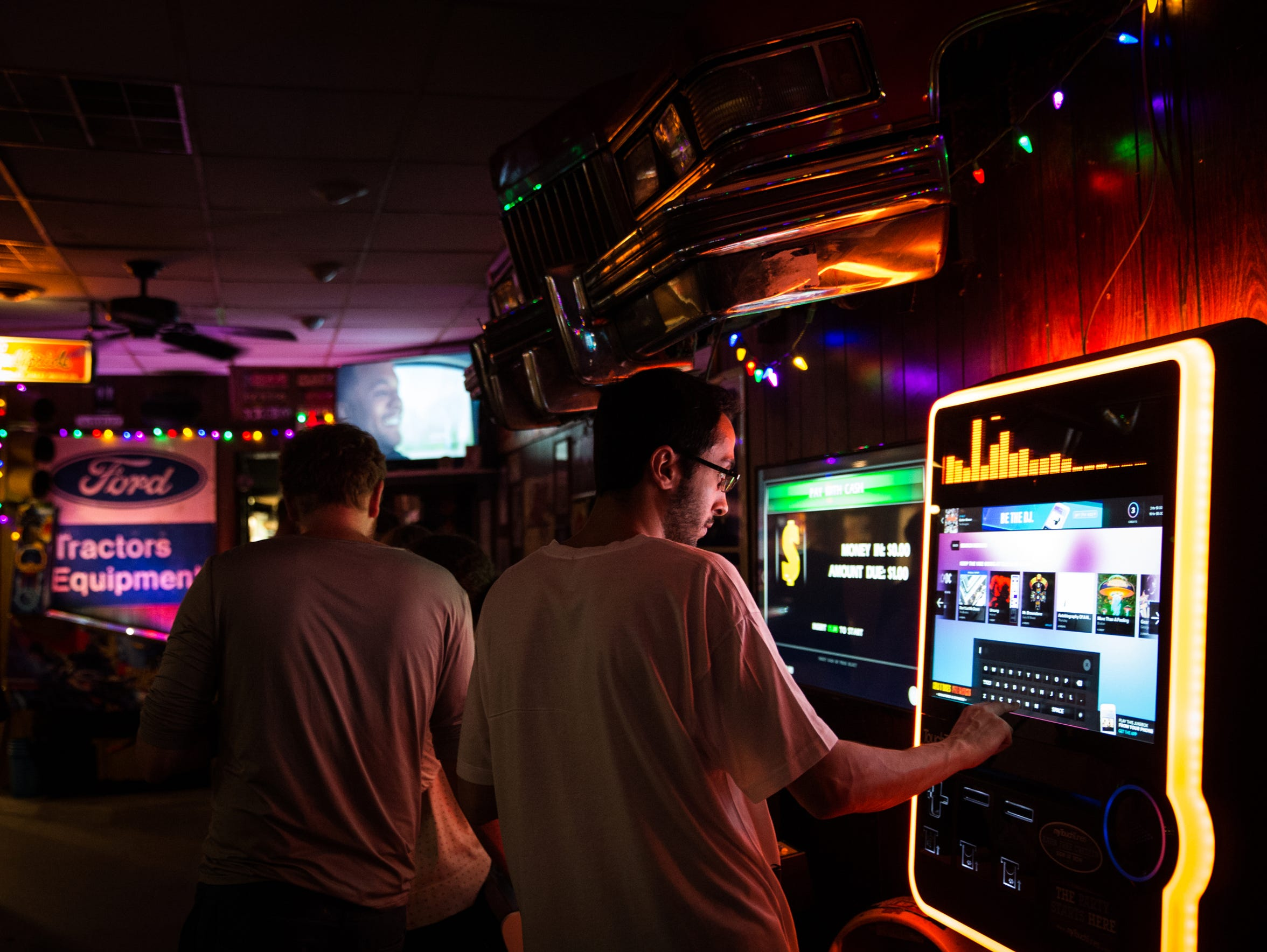 A man uses an internet jukebox at Gusoline Alley in