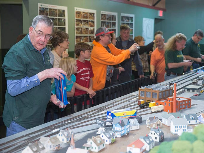 People attend the grand opening of the Miniature World of Trains exhibit in Greenville.