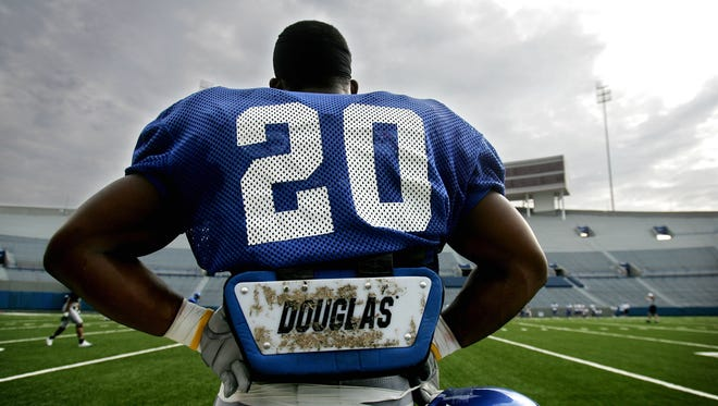 University of Memphis' DeAngelo Williams watches his team practice from the sidelines of the Liberty Bowl on Wednesday, August 17, 2005.