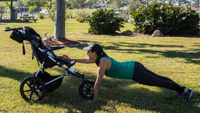 Atali Connor works out with her daughter Amelia, 1, at Camelot Park in Cape Coral. Connor is the owner and instructor of Baby Bootcamp in Cape Coral.