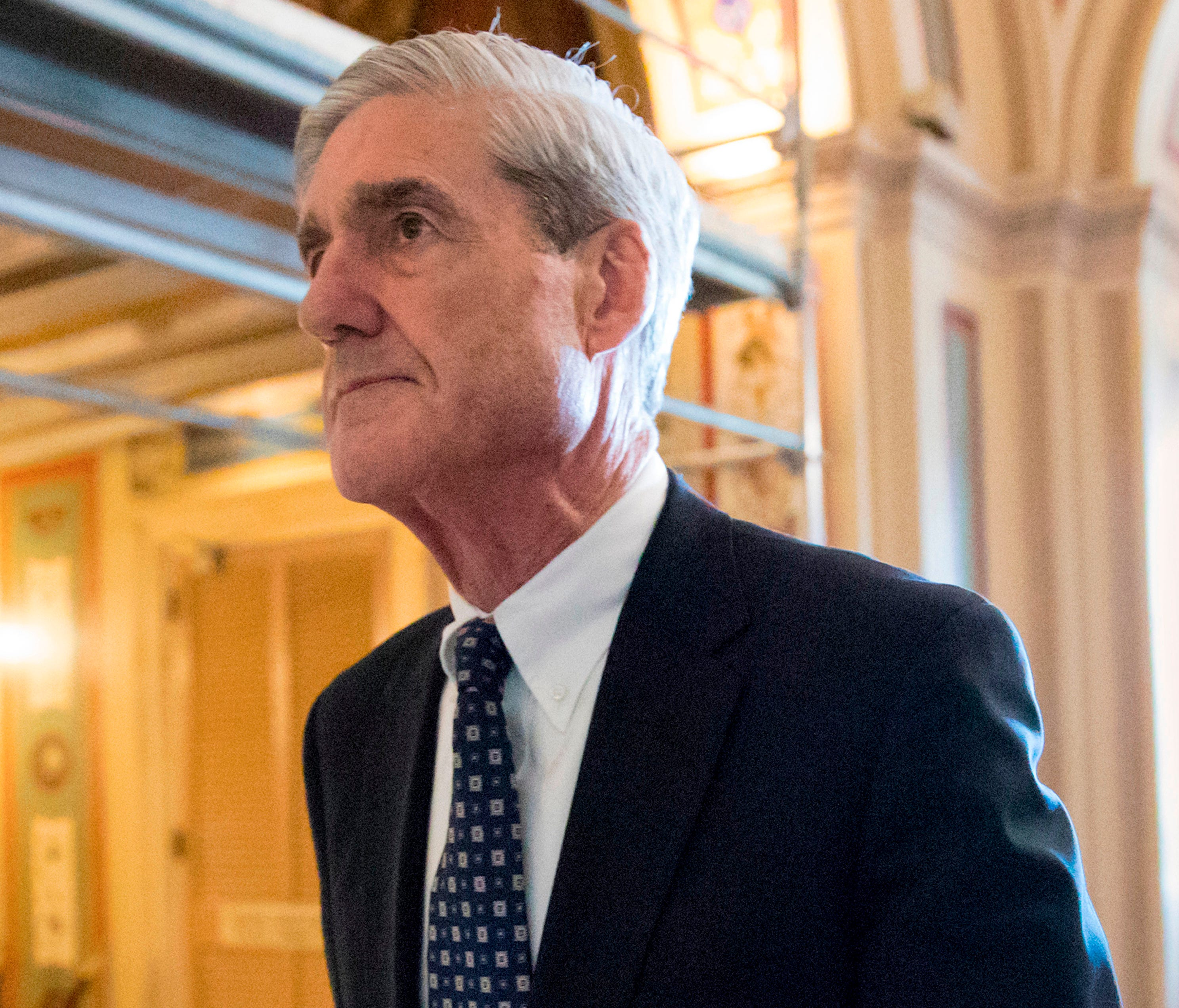 Special Counsel Robert Mueller departs after a meeting on Capitol Hill in Washington.