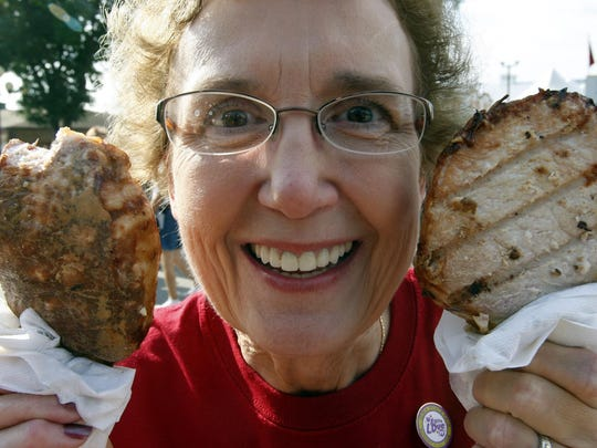 Martha Hawk of Wapello revels in two pork chops on a stick at the Iowa State Fair in 2008.