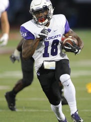 Justin Miller looks for running room after a catch