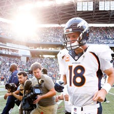 Sep 21, 2014; Seattle, WA, USA; Denver Broncos quarterback Peyton Manning (18) jogs off the field following a 26-20 overtime loss to the Seattle Seahawks at CenturyLink Field.