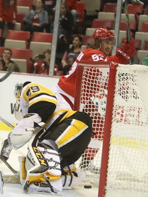 Red Wings forward Mitch Callahan scores against the Penguins goalie Marc-Andre Fleury during the first period of their exhibition Tuesday at Joe Louis Arena.