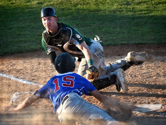 Campbellstown's Isaac Blatt is tagged at home plate by Fredericksburg catcher Michigan Daub in the fourth inning on Wednesday night.