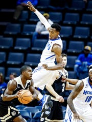 Memphis defender Jeremiah Martin (top) defends against