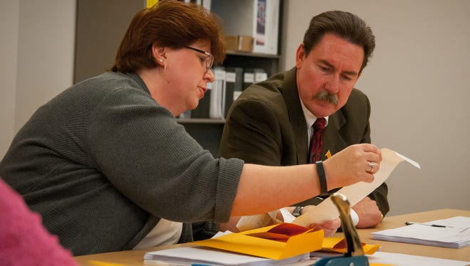 Las Cruces interim City Clerk Linda Lewis shows election results to state District Judge Jim Martin in November. Lewis was just named the new city clerk.