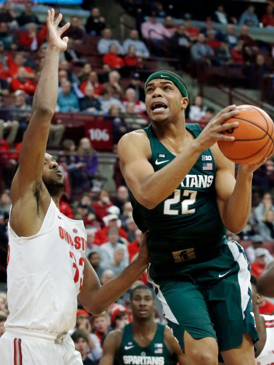 FILE - In this Jan. 7, 2018, file photo, Michigan State guard Miles Bridges, right, goes up for a shot against Ohio State forward Keita Bates-Diop during an NCAA college basketball game in Columbus, Ohio.  Michigan State is the top seed for the Big Ten conference tournament at Madison Square Garden in New York. Bridges draws the most attention from opposing defenses and is 16 of 20 from behind the arc over his last four games.  (AP Photo/Paul Vernon, File)
