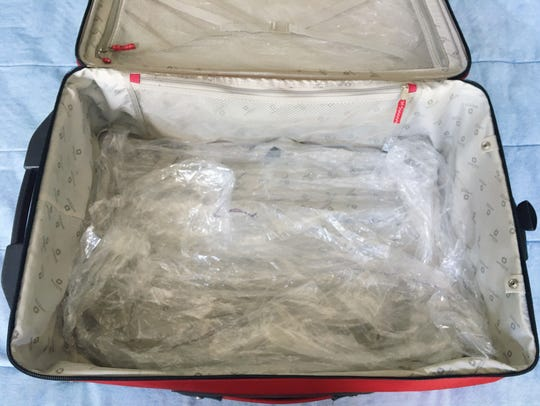 Line the bottom of your bag with dry cleaner bags to