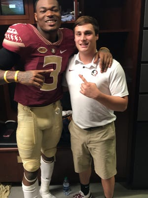 Merritt Island grad Casey Jackson (right) with Florida State football player Derwin James after a 2017 game.