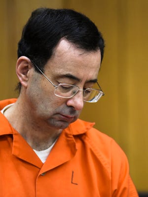 Larry Nassar looks down Feb. 5, 2018, on the third and final day of sentencing in Eaton County Court in Charlotte, Michigan. His appeal of his sentence on federal porn charges was denied Wednesday, Aug. 22, 2018.
