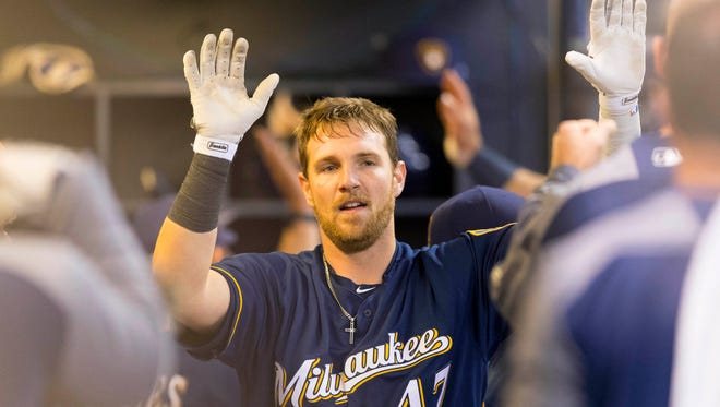 Brewers catcher Jett Bandy celebrates in the dugout after hitting a home run against the Cardinals.