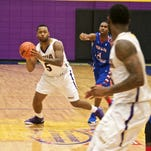 LSUA's Darryl Milburn (5) looks for an open man during Monday's game against Tougaloo.