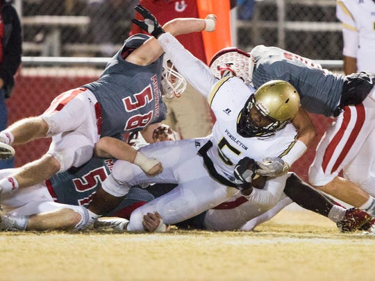 Pendleton's Brad Johnson (5) is tackled by a host of Palmetto defenders Friday.