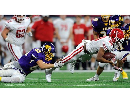 Wylie defensive lineman Ryan Hamar (83) tackles Carthage