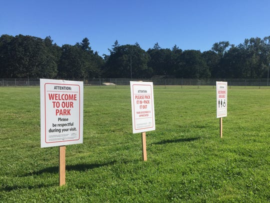 Signs welcoming campers at Bush's Pasture Park Friday.