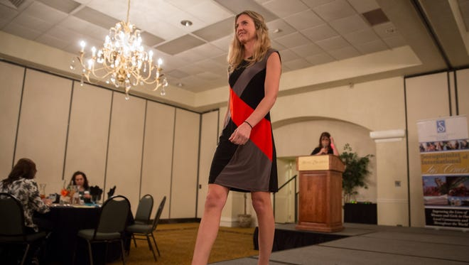 """Lauren Cunningham, a Soroptimist member for 6 years, models a """"business appropriate"""" outfit at the Soroptimist's Dream It, Be It Conference at the Hotel Encanto."""
