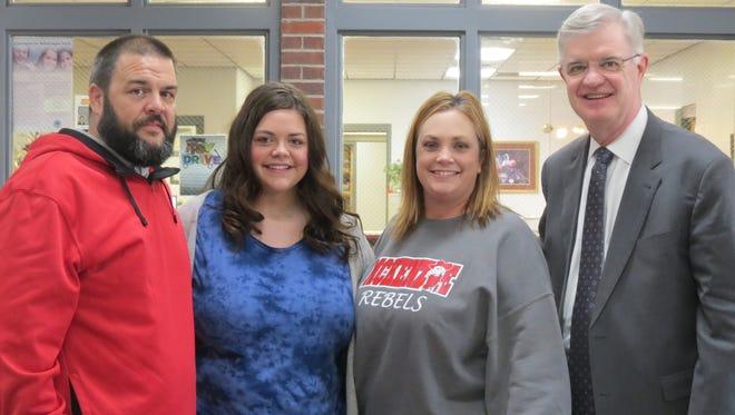 McKenzie High School senior Emma Renfro (second from left) was surprised by Bethel President Dr. Walter Butler (far right) when he arrived at MHS to announce she was one of two winners of the school's prestigious Hendrix Scholarship. As a winner, Renfro won full tuition for four years to Bethel. Also pictured are her parents Zach and Jill Renfro.