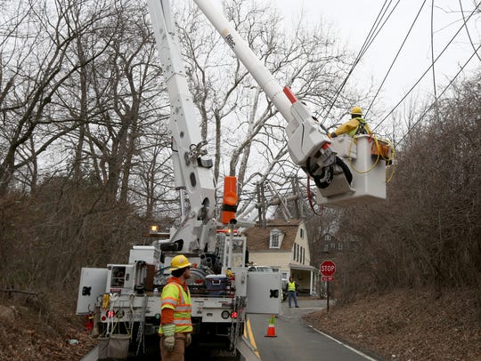 An Orange and Rockland crew repairs power lines on Storms Road in Valley Cottage on March 5, 2018. Power had been out in the neighborhood since March 2.