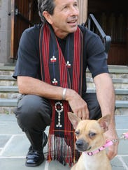 Pastor Kenneth Gill is shown with a newly adopted dog